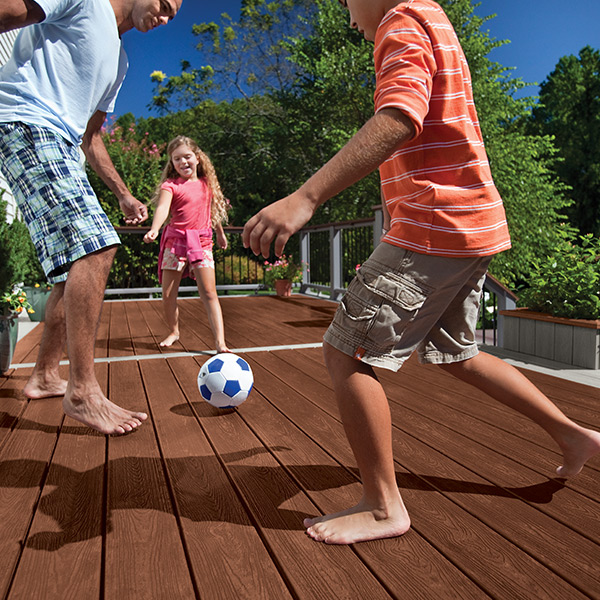 Barefoot on a Trex Transcend composite deck in Fire Pit red