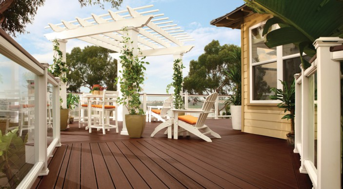 trex-transcend-decking-lava-rock-railing-classic-white-vintage-lantern-glass-panels-pergola-outdoor-furniture